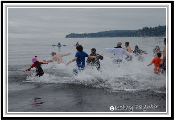 The first wave of people dashing into the water for the Annual Polar Bear Swim at Saratoga Beach near Campbell River.